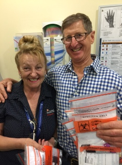 Tony displays the blood multiple blood samples taken by another friend nurse